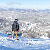 Snowboarder enjoying the view at Hunter Mountain