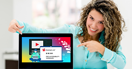 Smiling hispanic woman points at a laptop screen displaying CommonLook''s Webinar series banner