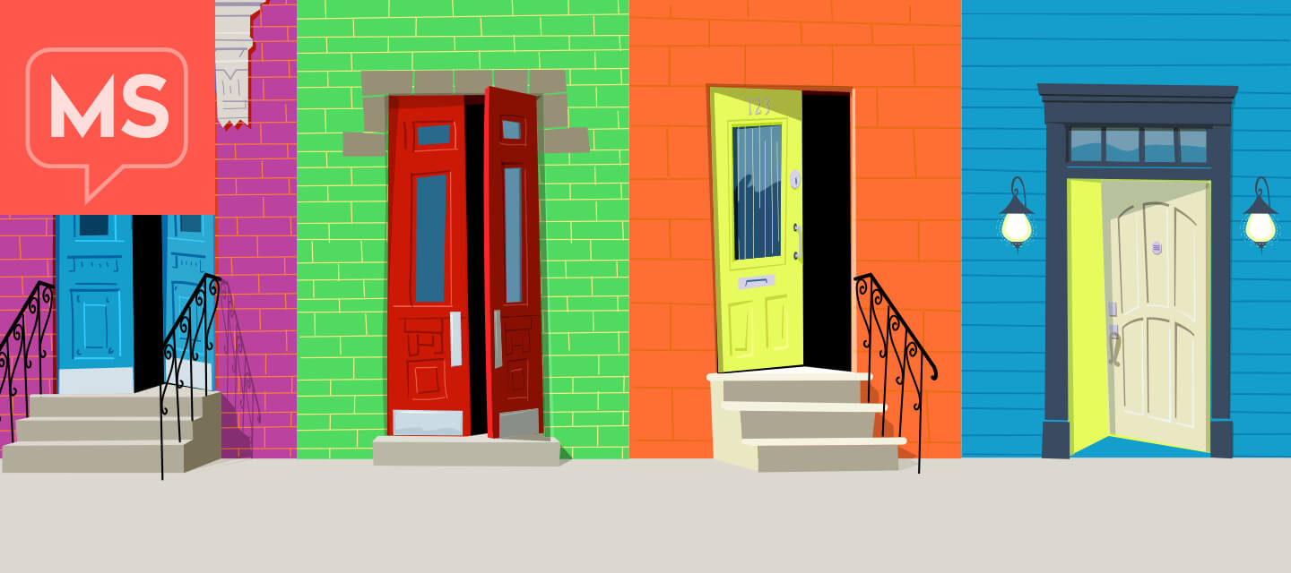 Four colorful and inviting front doors. Three of them have various levels of stairs leading to them and the lights are off inside. The last door is open with light streaming out of it. The door is on ground level and handicap accessible.