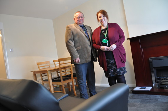 Cllr Steve Scotthorne and Christine Staniforth, Strategic Housing Manager stood in a housing unit living room