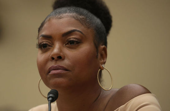 Close-up photo of actress Taraji P. Henson sitting in front of a black microphone