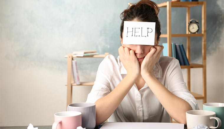 A photo of someone with a help note