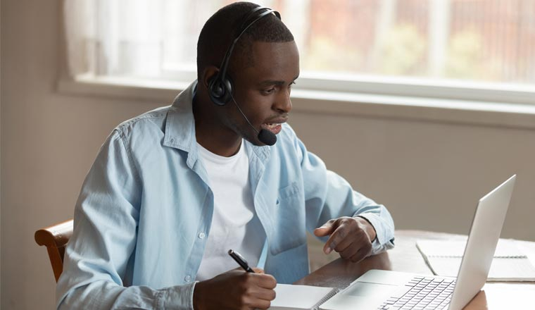 A picture of a remote agent sat in home office