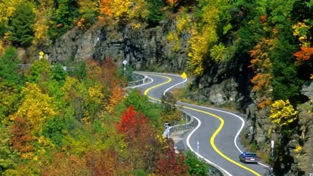 A winding road with fall foliage in New York State