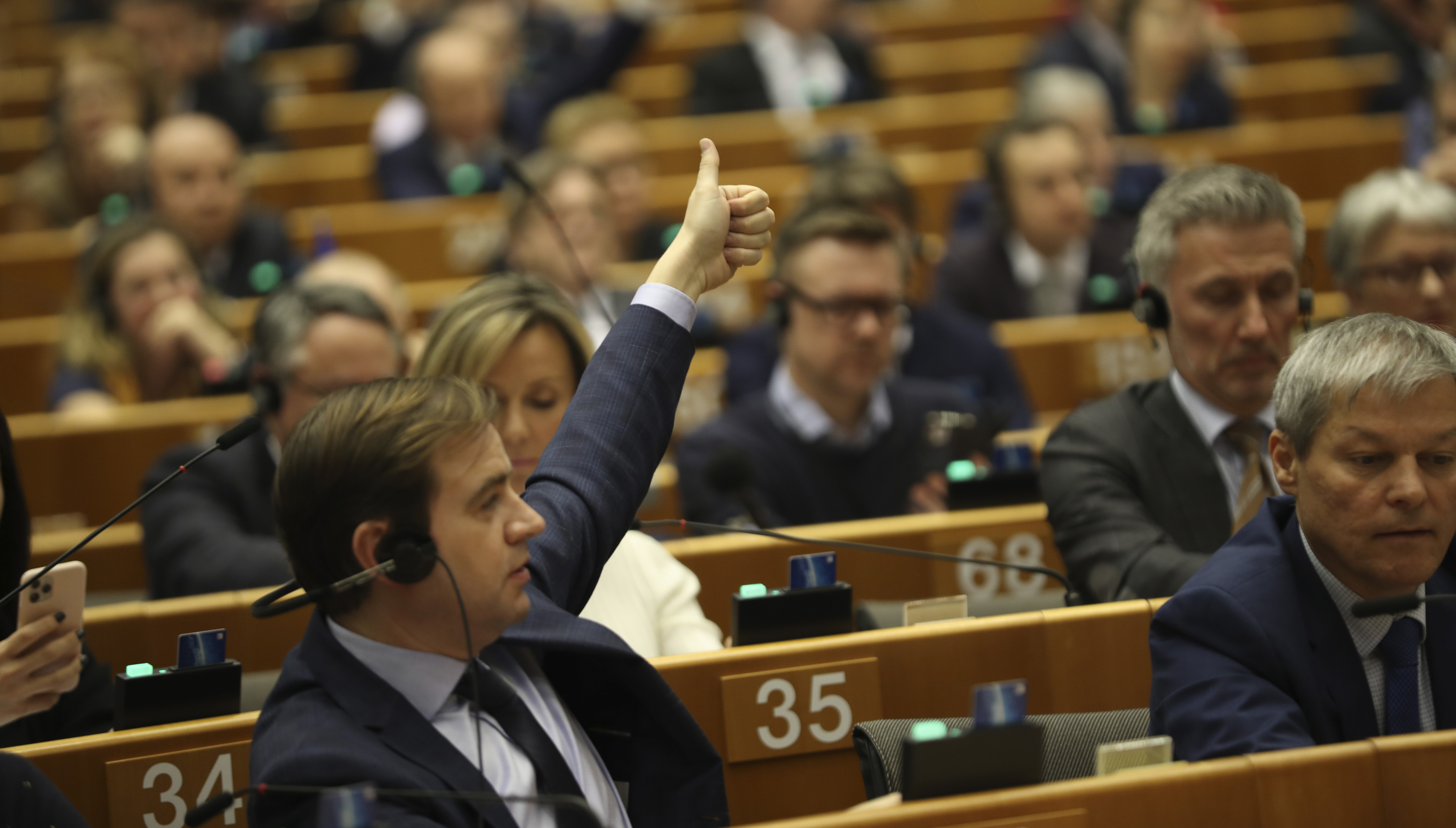 MEPs vote on the UK's withdrawal from the EU, the final legislative step in the Brexit proceedings, during the plenary session at the European Parliament in Brussels, Wednesday, Jan. 29, 2020. (AP Photo/Francisco Seco, Pool)