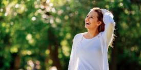 Woman walking outside in a white shirt - image