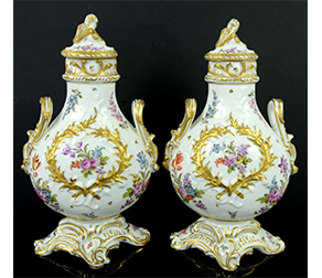 Pair of 19th Century Dresden porcelain twin handled bottle vases and covers