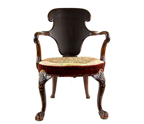 George I walnut splat back arm chair, with scrolled arms, tapestry seat