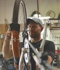 Jared tuning up a bike