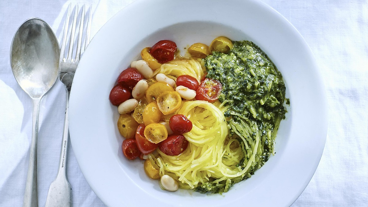 Spaghetti squash with roasted tomatoes, beans and almond pesto