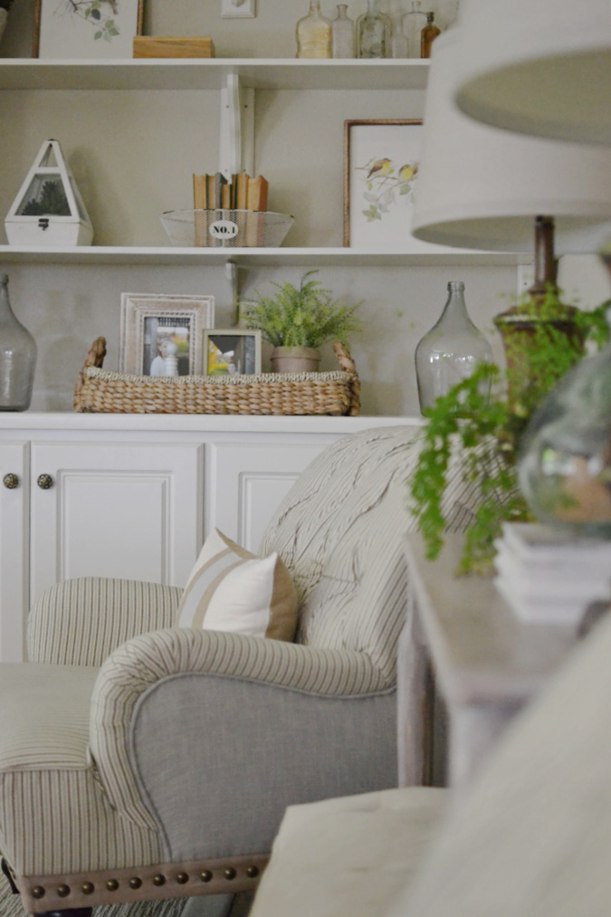 Ticking stripe chair in family room