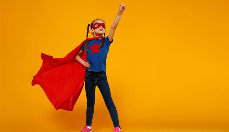 A picture of a super hero wearing a cape