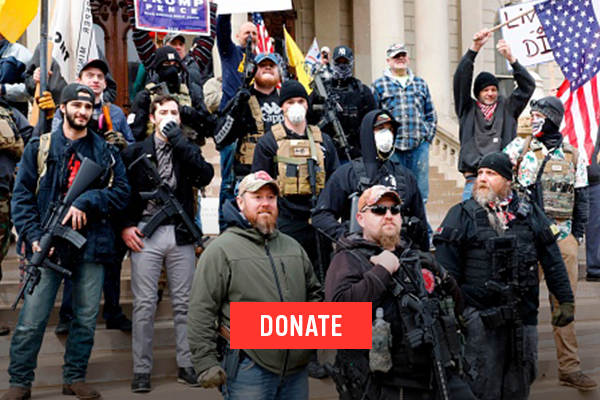 Armed extremists on the steps of the Michigan state capitol building