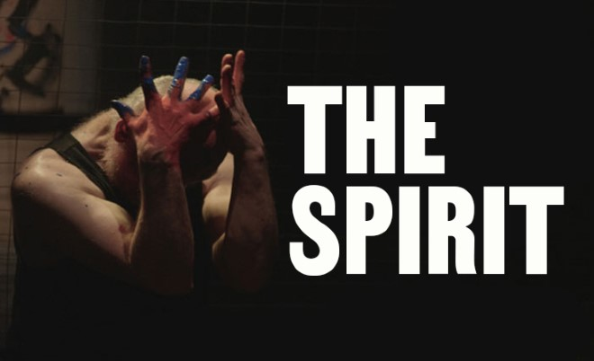 A figure clutches his head in his hands. Blue paint is visible on his fingers. Text: The Spirit