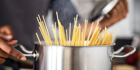 Spaghetti in a large silver pot - Image