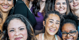 Group of women smiling at the camera  - image