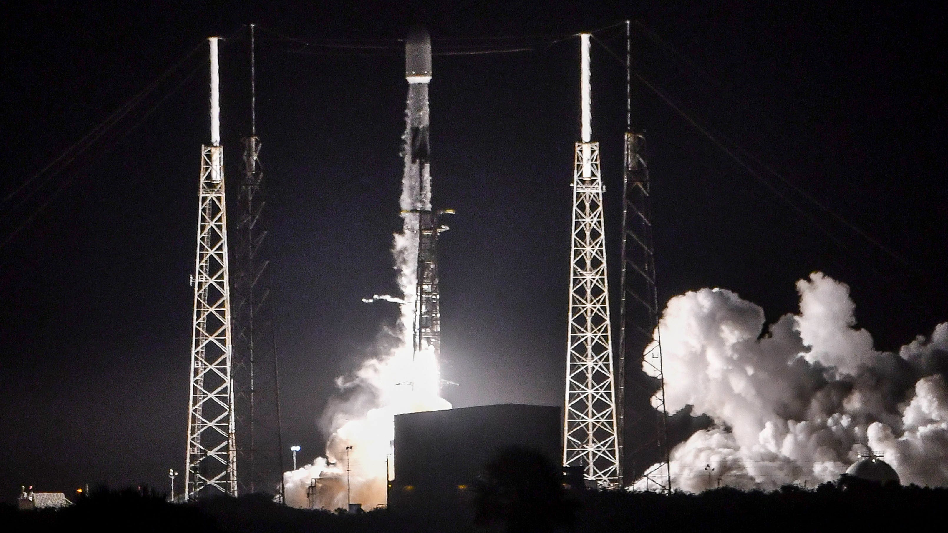 A SpaceX Falcon 9 rocket lifts off from Cape Canav
