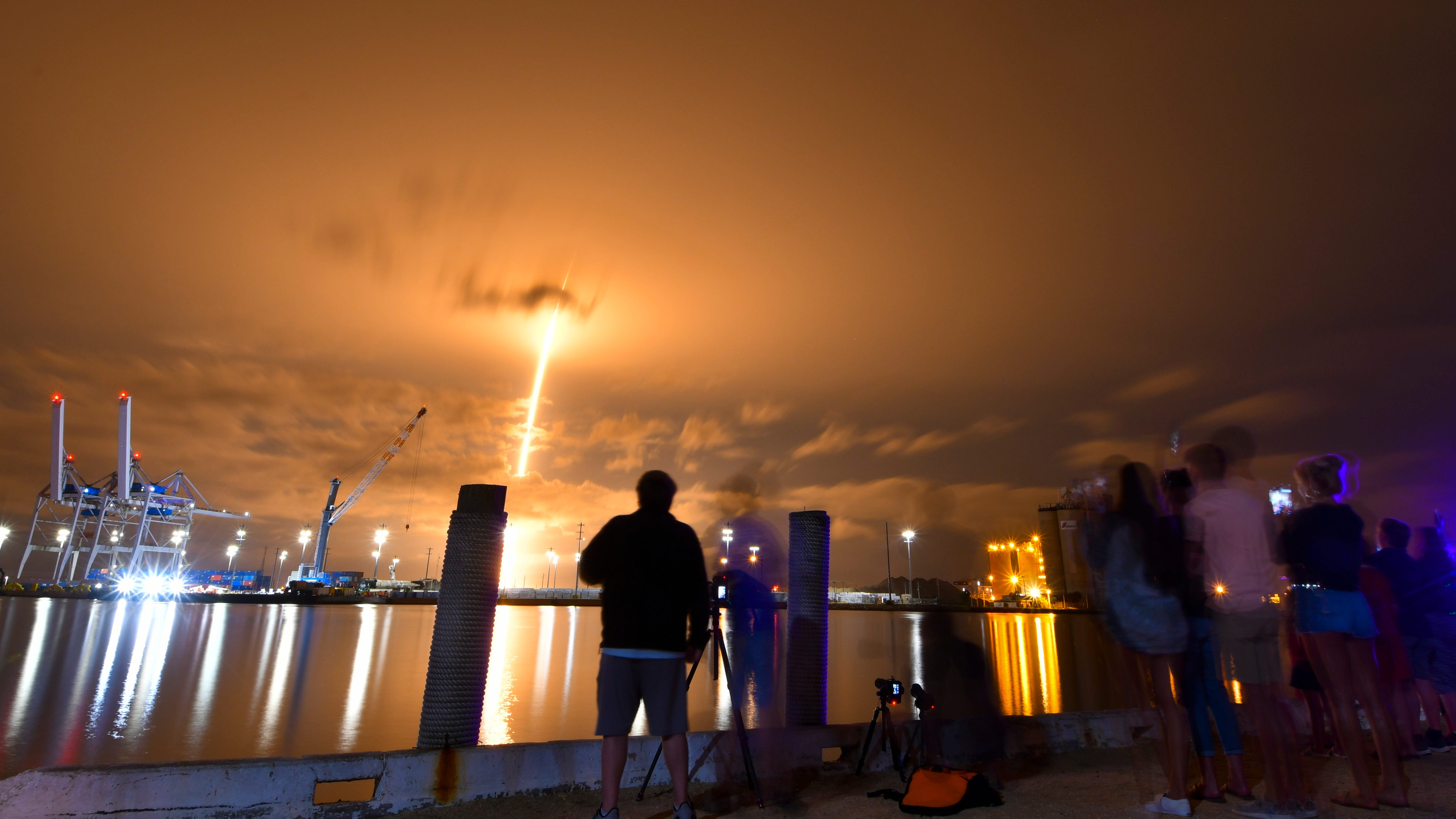 As seen from Port Canaveral: A SpaceX Falcon 9 rocket lifts off from Cape Canaveral Air Force Station's Launch Complex 40 on Wednesday, June 3, 2020 with 60 of the company's Starlink internet satellites.