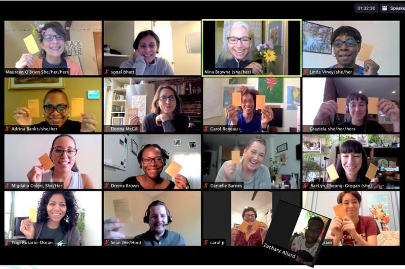 Screenshot of 16 smiling people in a Zoom meeting.