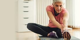 Woman doing yoga on a mat - image