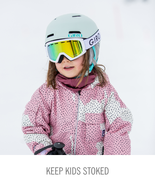 Girl dressed up in her giro helmet and goggles and namuk ski outfit