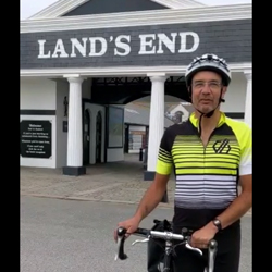 Alex Hills with bike at Land''s End