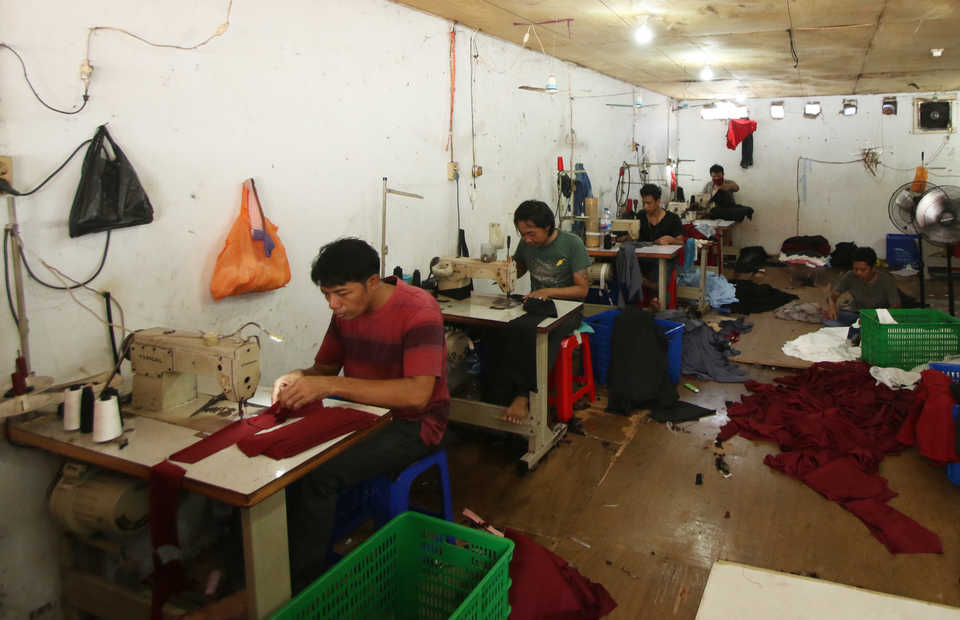 Tailors at a sewing house in Jakarta. (Antara Photo/Rivan Awal Lingga)