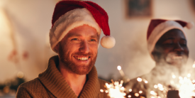 Man smiling in festive hat - image