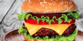 Cheeseburger on a wooden plate - image