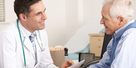 Older man speak with male doctor - Image
