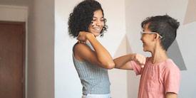 Girl and boy bump elbows - image