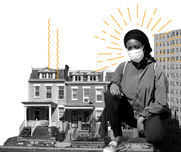 An African American woman wearing a mask in front of some row houses and a building.