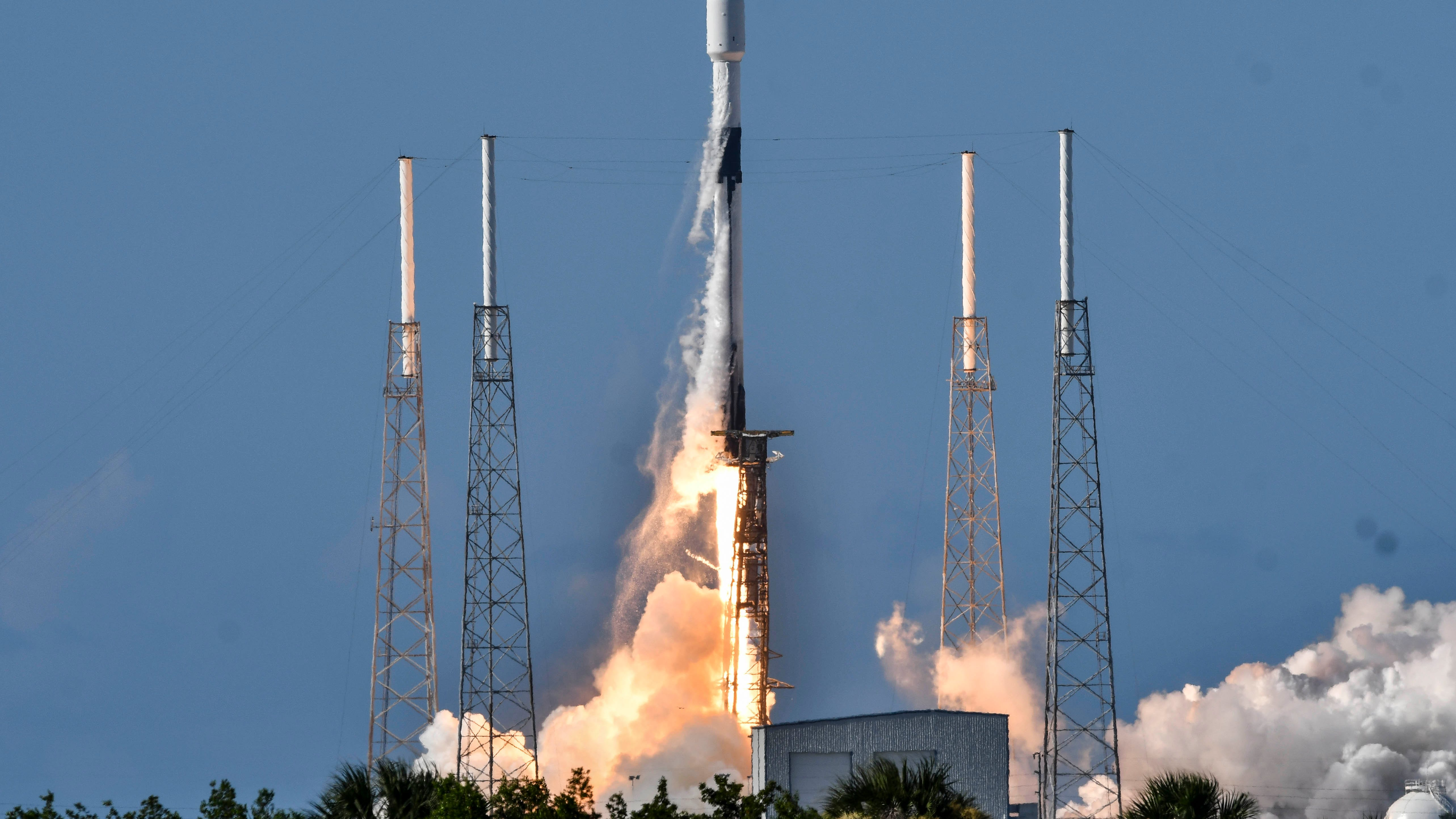A SpaceX Falcon 9 lifts off from Cape Canaveral Ai