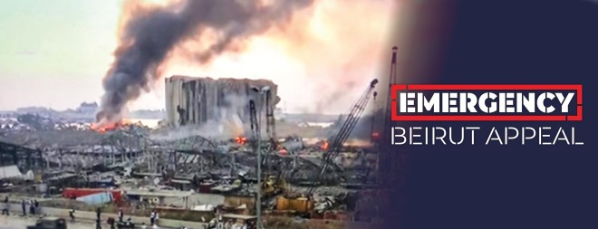 The aftermath of the explosion in Beirut, Lebanon. A building remains on fire in the port.