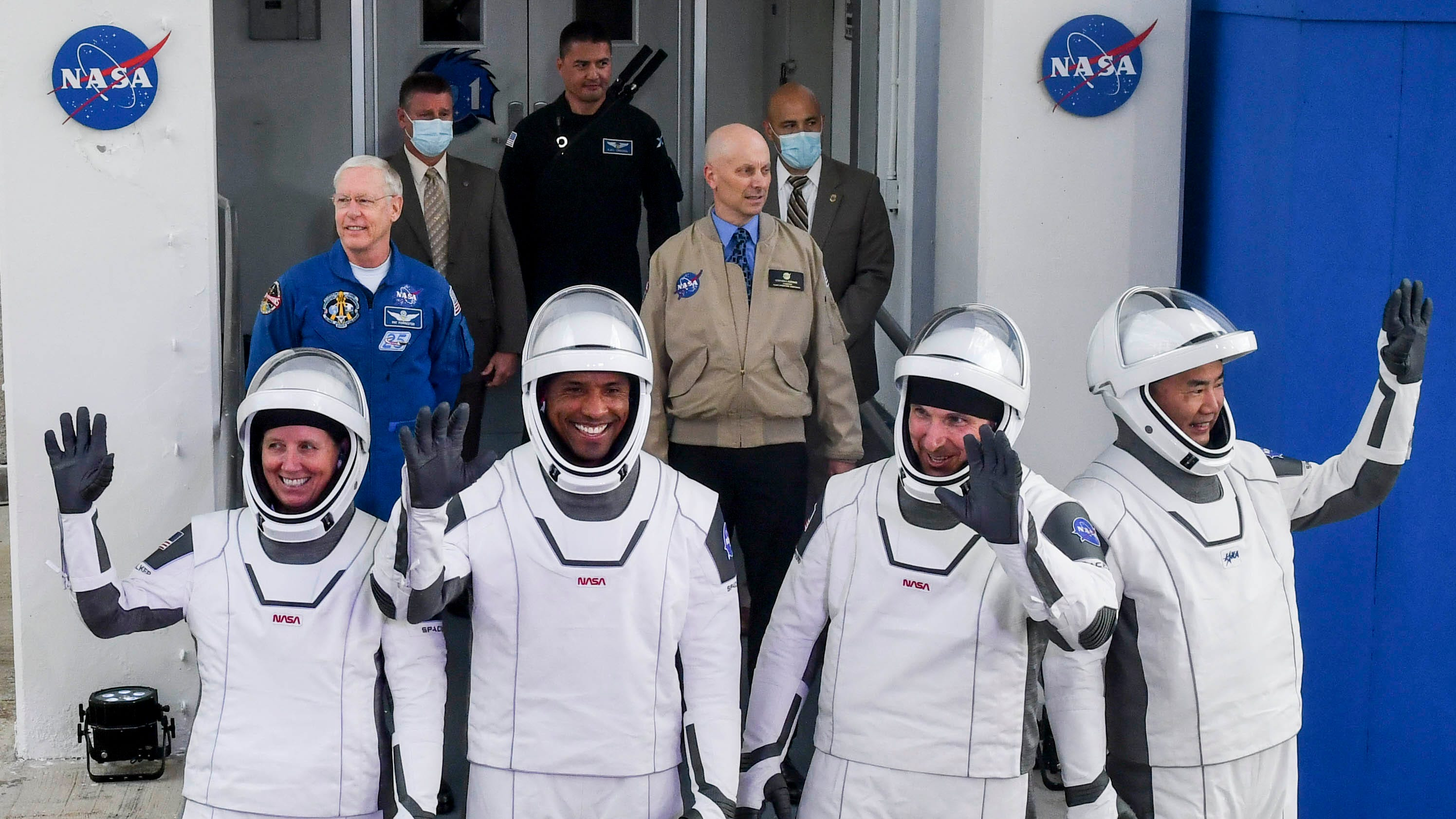 SpaceX Crew-1 astronauts Shannon Walker, Victor Glover, Michael Hopkins, and Soichi Noguchi wave to the crowd before heading to the launch pad Sunday, November 15, 2020. The four will ride a Falcon 9 rocket to the International Space Station.