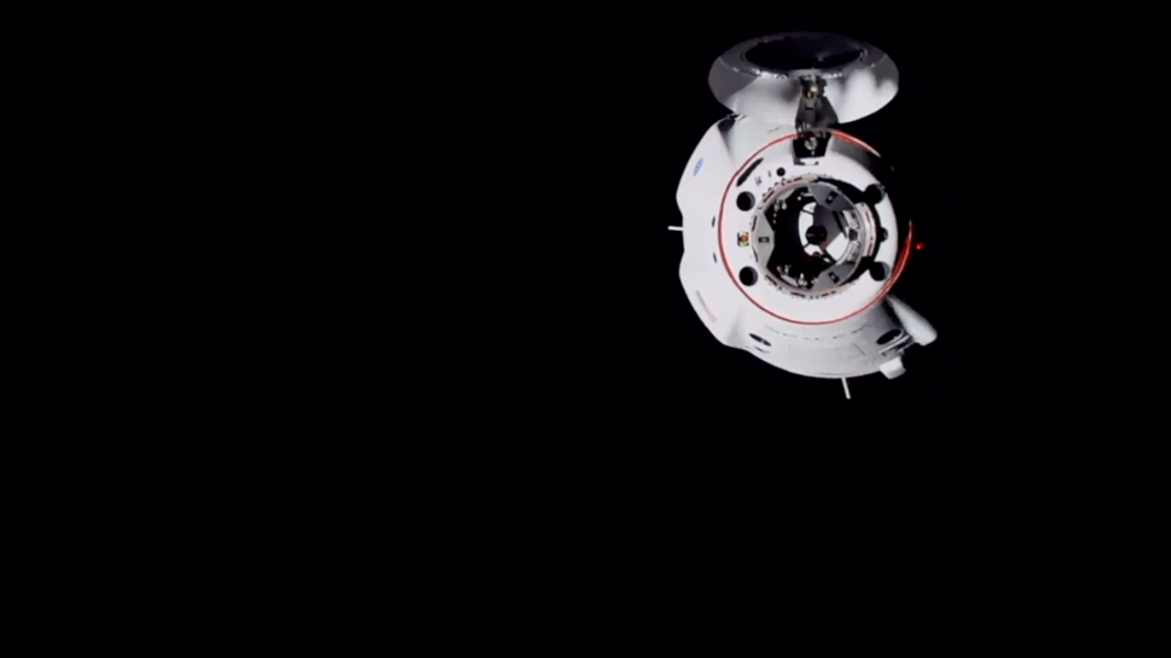 SpaceX's Crew Dragon capsule slowly approaches the