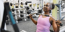 Mature woman exercising in a gym - image