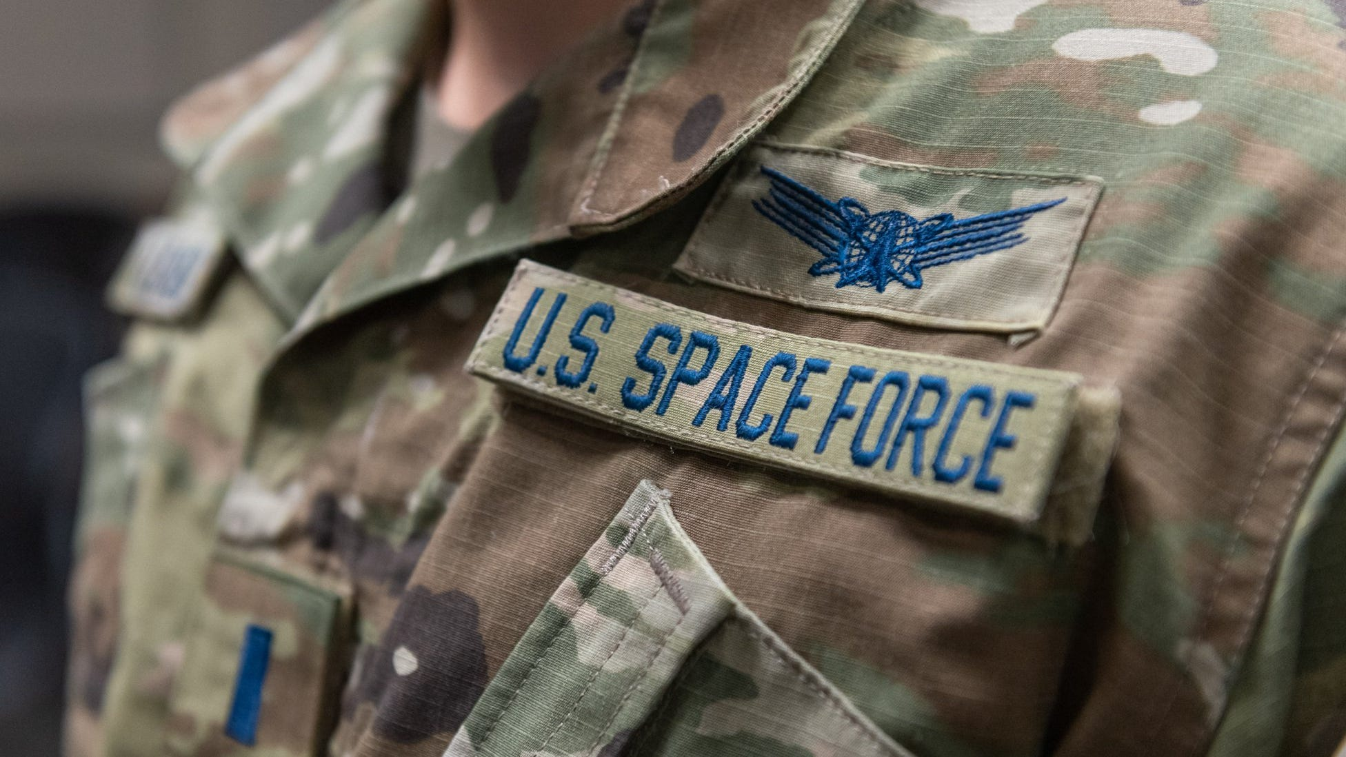 An airman is sworn into the Space Force by his com