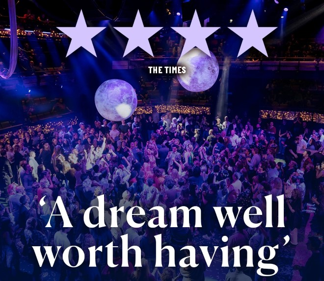 Image: A crowd dances together, bouncing around large inflatable moons. Text: 4 stars, The Times. ''A dream well worth having''