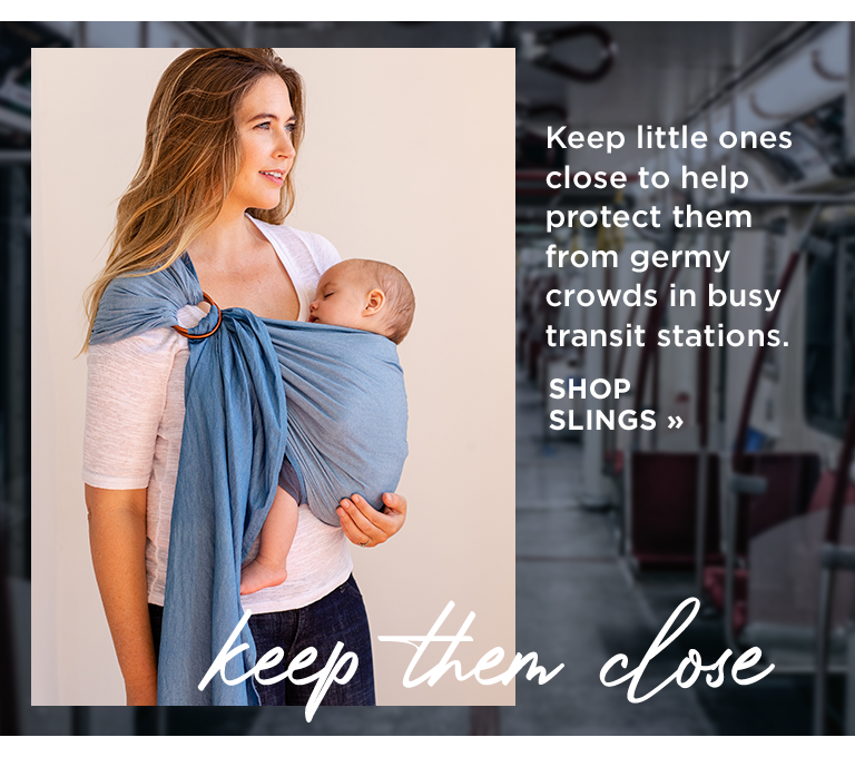 Keep little ones close to help protect them from germy crowds in busy transit stations. shop slings | keep them close