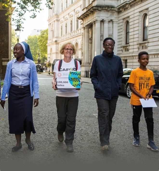 CAFOD volunteers walking on the street