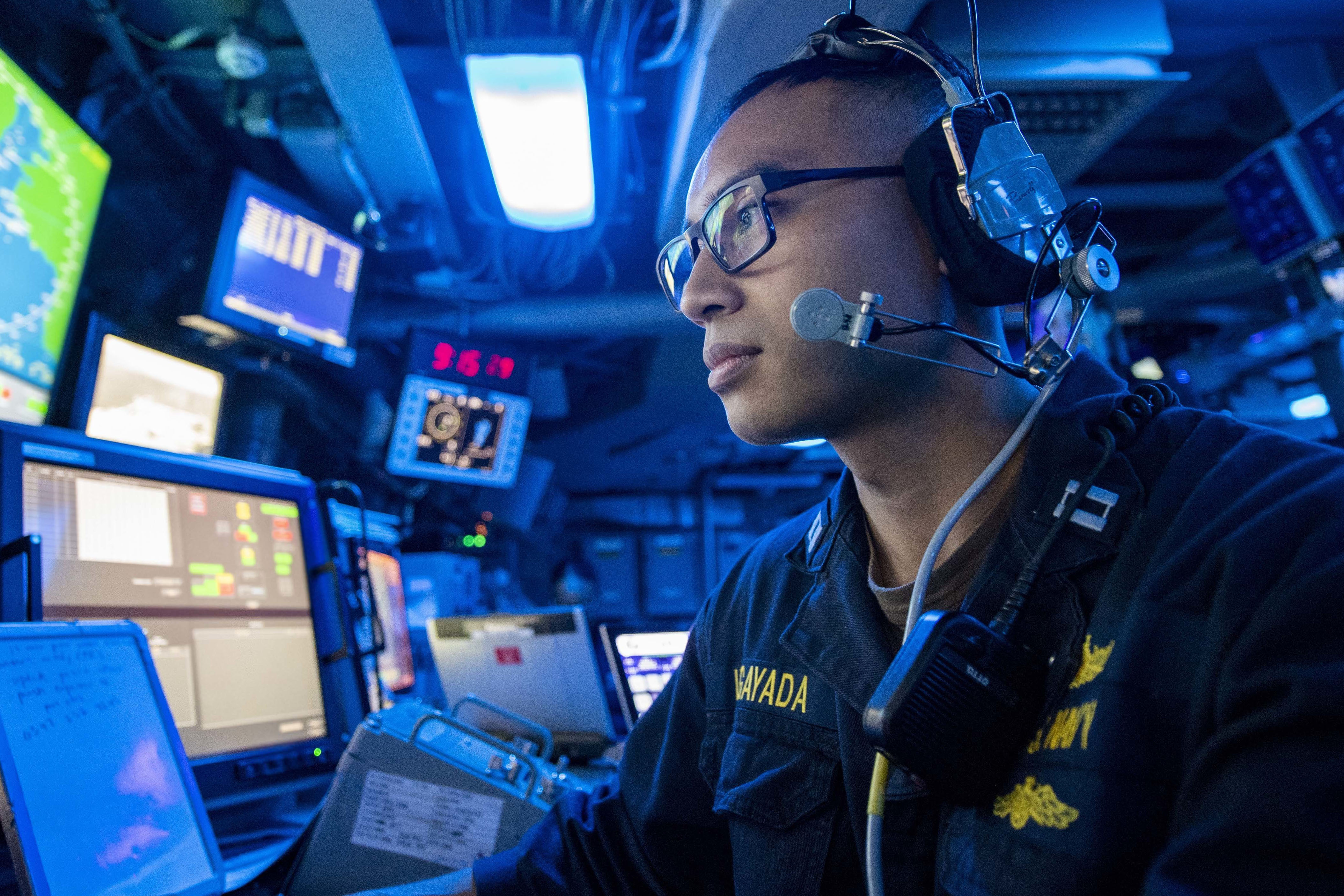 Navy Lt. Andrew Lagayada works in the command center aboard the USS John P. Murtha. (Navy Petty Officer 2nd Class Kyle Carlstrom/DoD)