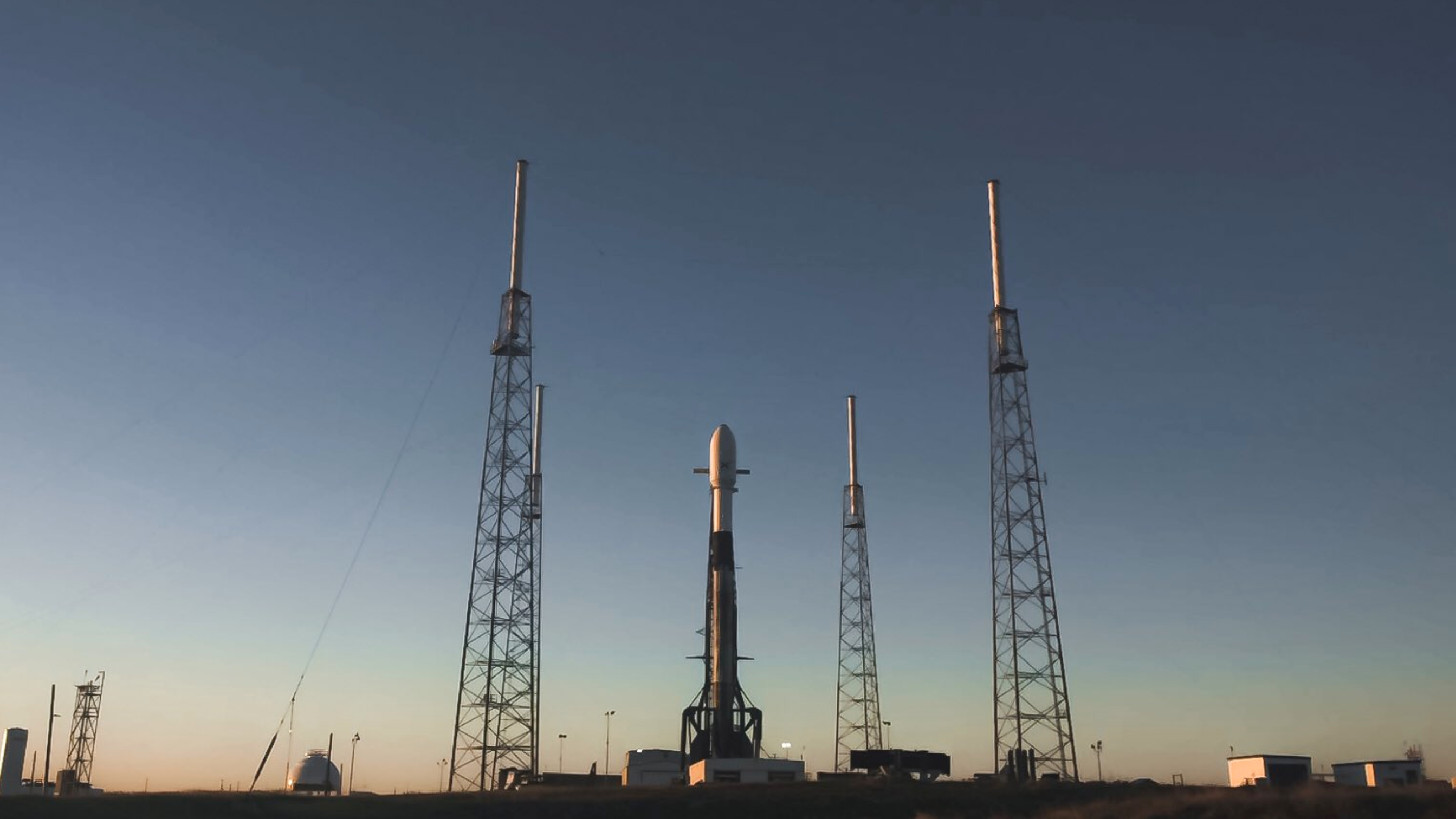 A SpaceX Falcon 9 rocket stands on the pad at Cape