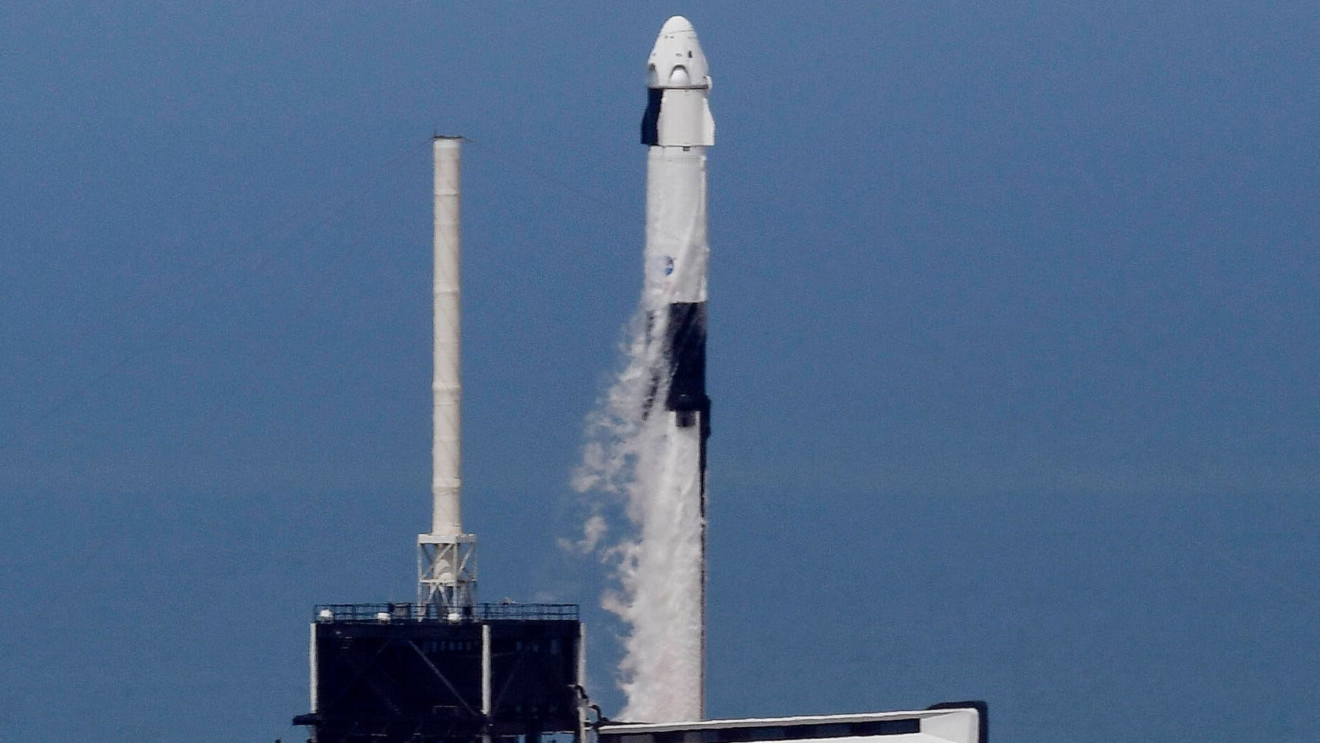 A SpaceX Falcon 9 rocket lifts off from pad 39A at Kennedy Space Center on Saturday, May 30, 2020, carrying astronauts Bob Behnken and Doug Hurley. The duo will spend one to four months on the International Space Station.
