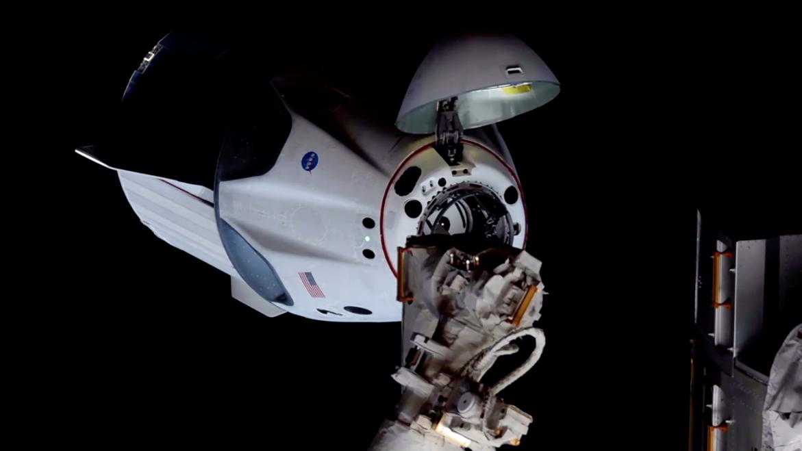SpaceX Crew Dragon capsule is seen just a few mete