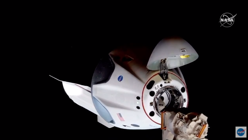 SpaceX Crew Dragon capsule is seen just a few mete