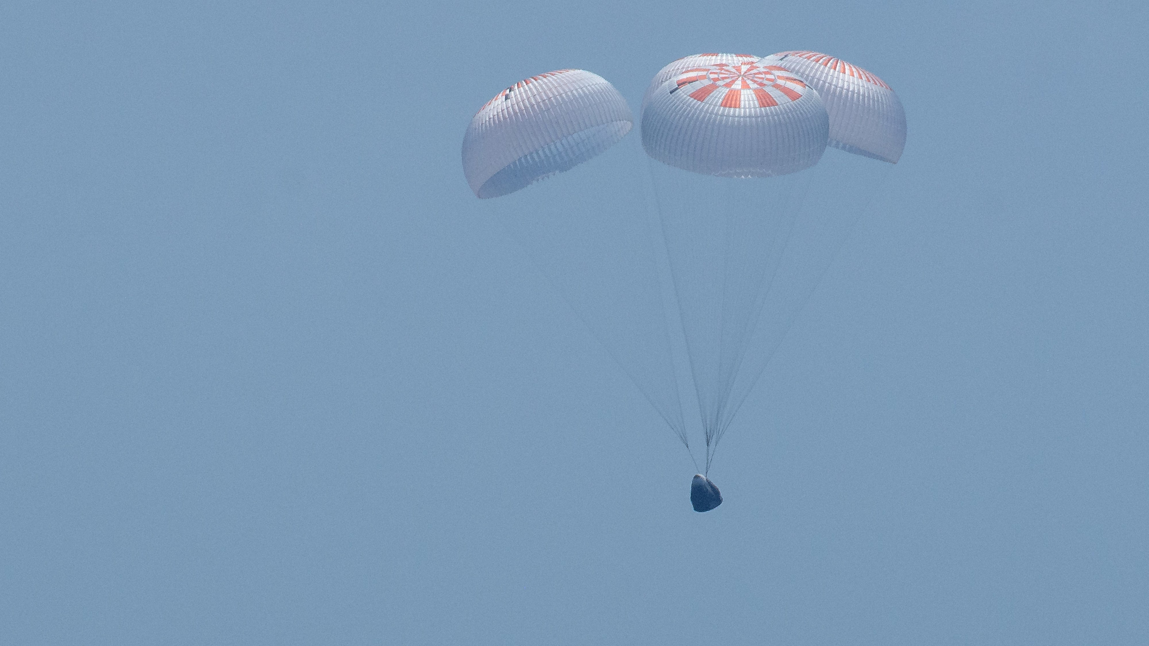 SpaceX's Crew Dragon capsule splashes down in the