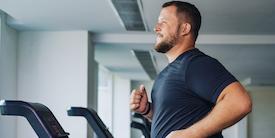 Man runs on treadmill - image