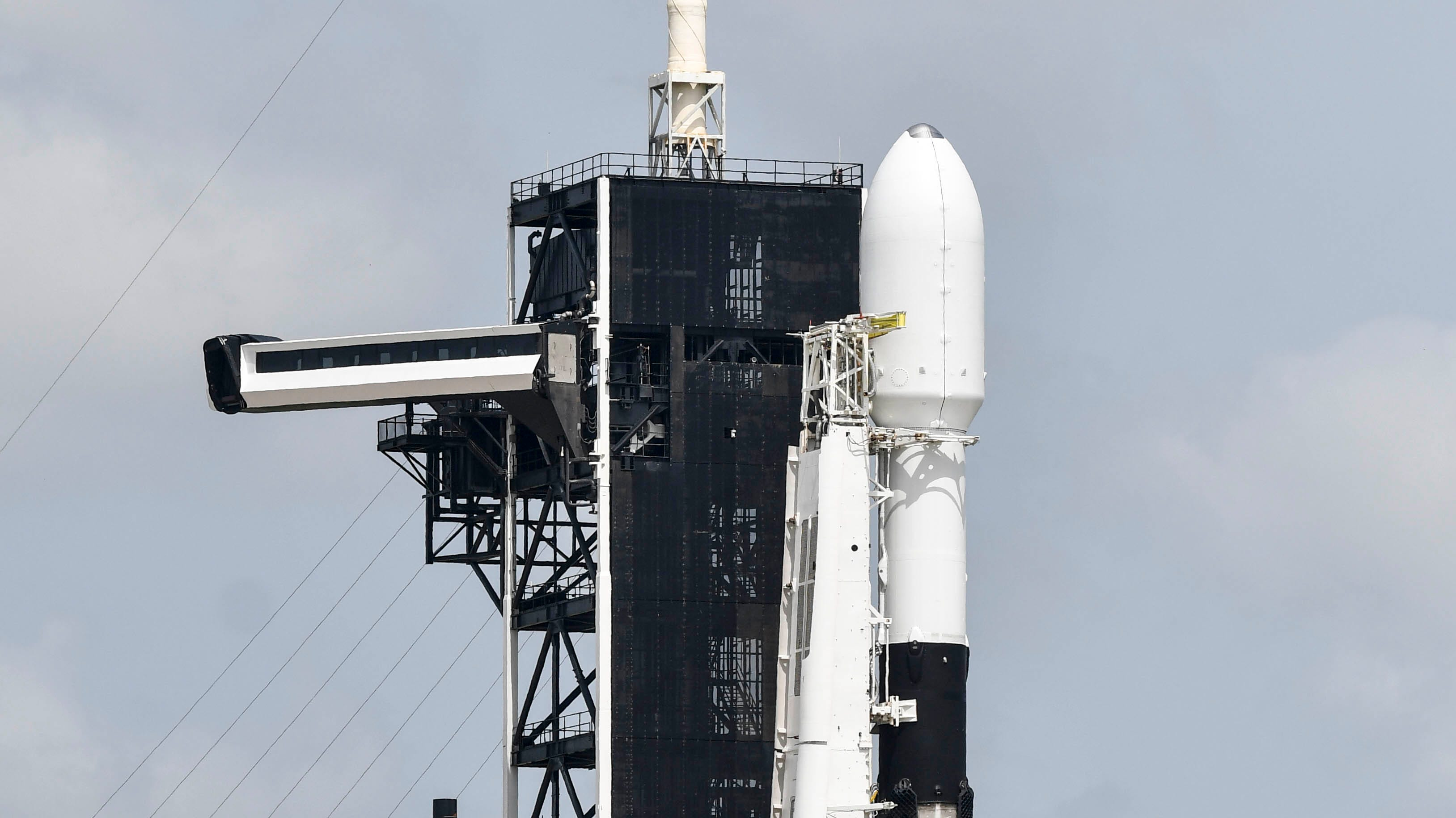 A SpaceX Falcon 9 remains on Pad 39A at Kennedy Sp