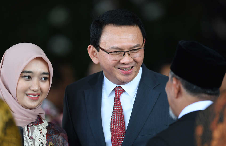 Former Jakarta governor Basuki 'Ahok' Tjahaja Purnama, center, at President Joko Widodo's inauguration last month. (Antara Photo/Wahyu Putro A.)